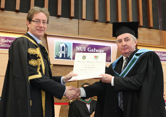 Former RTƒ Marine Correspondent, Tom MacSweeney who was conferred with an Honorary Master of Science (MSc) by the University today with NUI Galway President, Dr Jim Browne. Photograph by Aengus McMahon